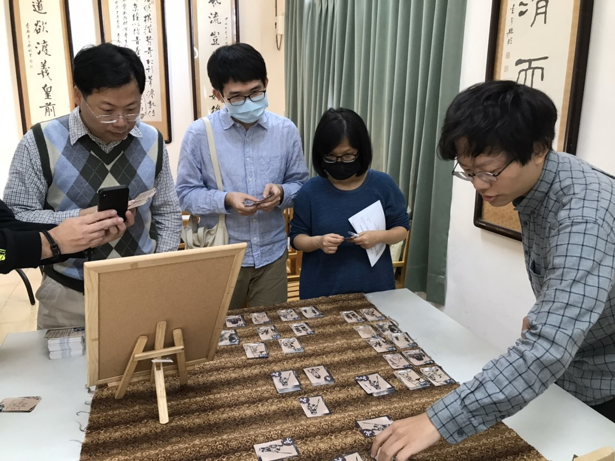 The students and teachers test board games designed by the students
