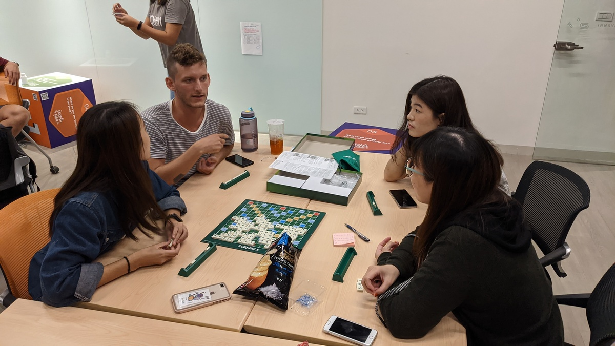 Students playing board games in English
